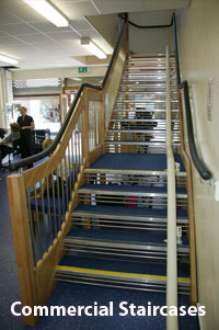 European Style Staircase + Continuous Handrail in a commercial property