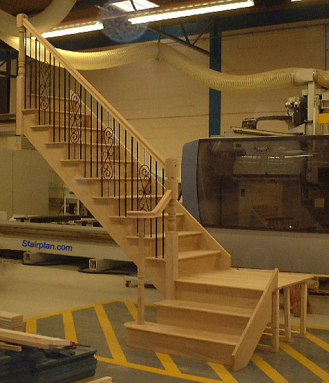 Oak Cut String staircase with a quarter landing and volute